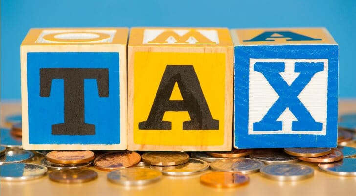 "The word ""TAX"" spelled out with blocks"